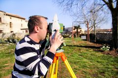 Surveyor worker making measurement in the garden, total station Royalty Free Stock Photos