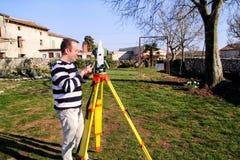 Surveyor worker making measurement in the garden, total station Stock Photos