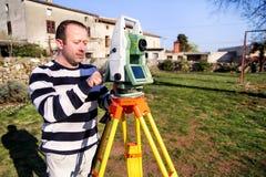 Surveyor worker making measurement in the garden, total station Stock Photo