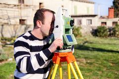 Surveyor worker making measurement in the garden, total station Royalty Free Stock Images