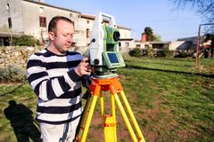 Surveyor worker making measurement in the garden, total station Royalty Free Stock Photo