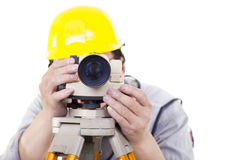 Surveyor worker making measurement  and isolated Royalty Free Stock Photos
