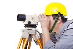 Surveyor worker making measurement  and isolated Stock Image