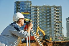 Surveyor worker with theodolite Royalty Free Stock Photography
