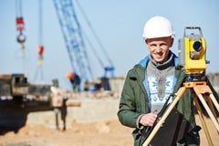 Surveyor worker with theodolite Stock Photo
