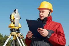 Surveyor worker with theodolite royalty free stock photo
