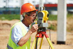 Surveyor worker with theodolite Royalty Free Stock Image