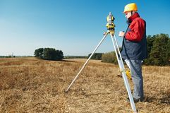 Surveyor worker with theodolite stock images
