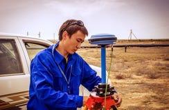 Surveyor. Working in the desert Betpakdala, June 2015 stock photos