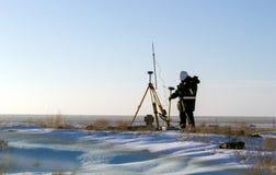 Surveyor. Surveyor working in the desert in the winter stock photos