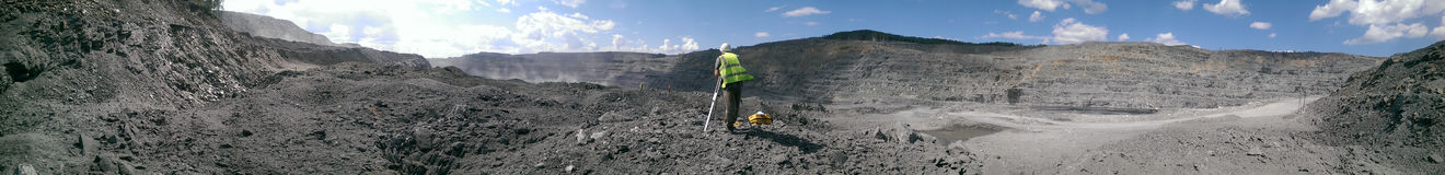 surveyor working in the mining quarry Royalty Free Stock Images