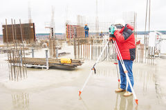 Surveyor working with theodolite equipment Royalty Free Stock Photography