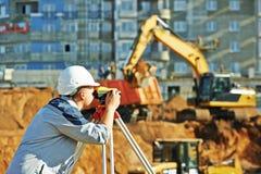 Surveyor working with theodolite equipment Royalty Free Stock Photo