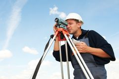Surveyor works with theodolite. One surveyor worker with theodolite equipmant outdoors input the data Stock Photos