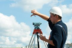 Surveyor works with theodolite. One surveyor worker with theodolite equipmant outdoors Stock Image