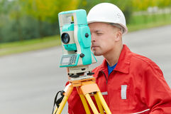 Surveyor works with theodolite. One surveyor worker with theodolite equipmant outdoors input the data Stock Photography