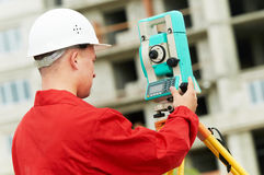 Surveyor works with theodolite. One surveyor worker with theodolite equipmant outdoors input the data Stock Images