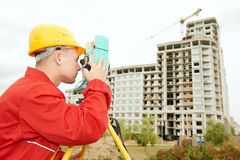 Surveyor works with theodolite. One surveyor worker with theodolite equipmant outdoors input the data Royalty Free Stock Photography