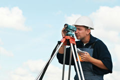 Surveyor works with theodolite. One surveyor worker with theodolite equipmant outdoors Royalty Free Stock Images