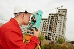 Surveyor works with theodolite. One surveyor worker with theodolite equipment outdoors input the data Stock Photos