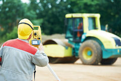 Surveyor works with theodolite. One surveyor worker working with theodolite transit equipment at road construction site outdoors Stock Photography