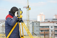 Surveyor works with theodolite. One surveyor worker working with theodolite transit equipment at construction site outdoors Royalty Free Stock Image