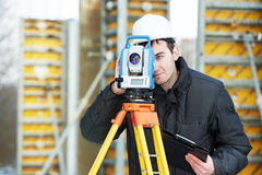 Surveyor works with theodolite. One surveyor worker working with theodolite transit equipment at road construction site outdoors Royalty Free Stock Images