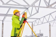 Surveyor works with theodolite Stock Image