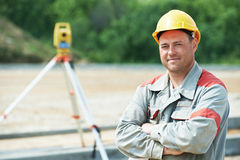 Surveyor works with theodolite Royalty Free Stock Images