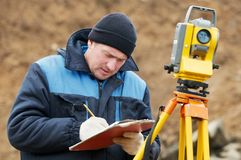 Surveyor works with total station Royalty Free Stock Images