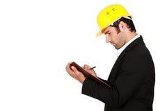 Surveyor writing on a clipboard Stock Image