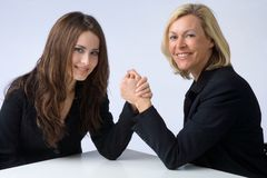 Survival of the fittest. Two businesswomen are arm wrestling Royalty Free Stock Photo