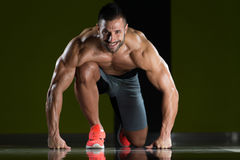 Survival Of The Fittest. Strong Muscular Men Kneeling On The Floor - Almost Like Sprinter Starting Position Stock Images