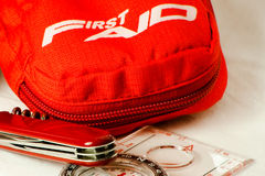 Survival kit. Compass, knife and first aid kit, ready for an amazing adventure Royalty Free Stock Image