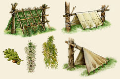 Survival shelters in the woods Stock Images