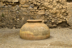 Surviving the amphorae in ancient Pompeii. Royalty Free Stock Photo
