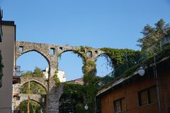 Old Italian aqueduct. The surviving fragment old of Italian aqueducts in the city of Salerno. Partially preserved ancient water supply Stock Images