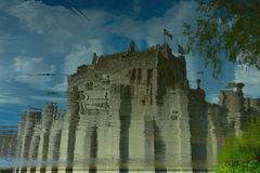 the only surviving medieval fortress in Flanders: Gravensteen & x28;name of the castle& x29; reflextion in water. Stock Photo