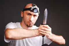 Survivor man. Portrait of a survivor  thinking on a gray background Stock Image