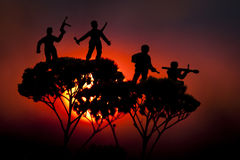 Survivors. Soldiers silhouettes against a sunset Royalty Free Stock Photo