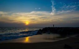 Suryanamaskar on beach Stock Images