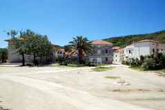 Susak village near Mali Losinj in Croatia. Main square in Susak village near Mali Losinj island with a blue sky Stock Image