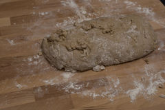 Susamielli. Sweet traditionale Christnas Italian. Susamielli Sweet mixture of traditionale Italina Christnas. wooden background covered with white flour. Kneaded stock photo