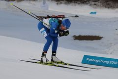 Susan Dunklee of the United States competes in biathlon Women`s 15km Individual at the 2018 Winter Olympics. PYEONGCHANG, SOUTH KOREA - FEBRUARY 15, 2018: Susan Stock Photos