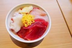 Sush sashimii rice bowl with octopus , Hamachi ,Tuna and ikura salmon egg roe royalty free stock photos