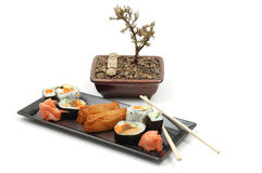 Sushi #1. Plate of sushi with bonsai tree in background Stock Photography