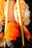 Sushi. Traditional japanese sushi close-up and chopsticks royalty free stock photo
