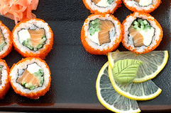 Sushi. Close up with a slice of a lemon and a red fish Stock Photography