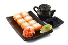 Sushi. With sauce on a support on a white background Stock Photo