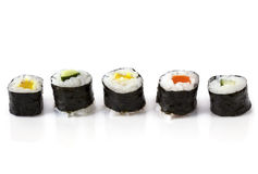 Sushi. Rolls, in a row, isolated on white with reflection Royalty Free Stock Photos